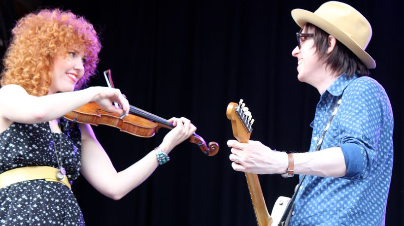 Eleanor Whitmore (left) and Chris Masterson perform as members of Steve Earle and the Dukes at the 2013 Ride Festival in Tell