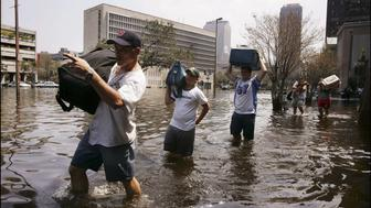 UNITED STATES - SEPTEMBER 03:  Hurricane Katrina Aftermath In New Orleans, United States On September 03, 2005 - Evacuation of citizen living in the flooded area near the Superdome.  (Photo by Laurent VAN DER STOCKT/Gamma-Rapho via Getty Images)