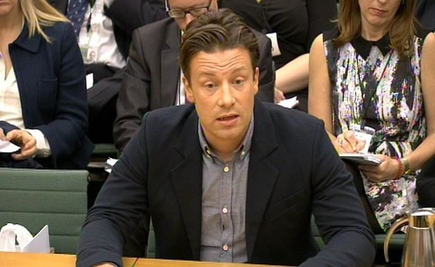 Jamie Oliver has branded Theresa May's plans to scrap free school meals for infants a