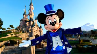 Disney character Mickey mouse poses in front of the Sleeping Beauty Castle to mark the 25th anniversary of Disneyland - originally Euro Disney Resort - on March 16, 2017 in Marne-La-Vallee, east of the French capital Paris. The 25th anniversary celebrations will begin on March 26, 2017 with parades, various shows and a firework's display. / AFP PHOTO / BERTRAND GUAY        (Photo credit should read BERTRAND GUAY/AFP/Getty Images)