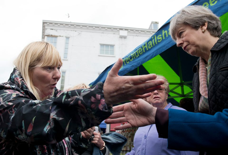 Kathy Mohan confronts Theresa May about cuts to disability benefits last