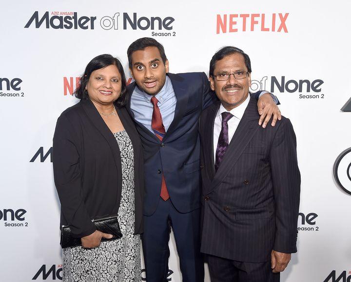 Aziz Ansari (center) with his parents Fatima Ansari and Shoukath Ansari attend the 'Master Of None' Season 2 Premiere at SVA
