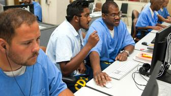 SAN QUENTIN, CA - SEPTEMBER 27: Inmates serving time at San Quentin prison learn how to code as part of The Last Mile program, on September 27, 2016 in San Quentin, California. Inmates learn a skill - coding - that can ensure they will get good-paying jobs when they are released. The governor says he will reduce the prison population by 30% in two years. (Photo by Melanie Stetson Freeman/The Christian Science Monitor via Getty Images)