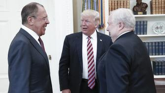 WASHINGTON, D.C., USA - MAY 10, 2017: Russia's Foreign Minister Sergei Lavrov, US President Donald Trump, and Russia's Ambassador to the United States Sergei Kislyak (L-R) during a meeting in the Oval Office at the White House. Alexander Shcherbak/TASS (Photo by Alexander Shcherbak\TASS via Getty Images)
