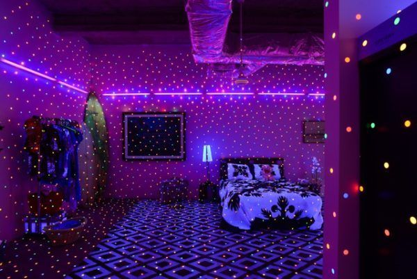 Yayoi Kusama (b. 1929); I'm Here But Nothing; 2000/2017; vinyl stickers, UV lights, furniture, household objects, dimensions