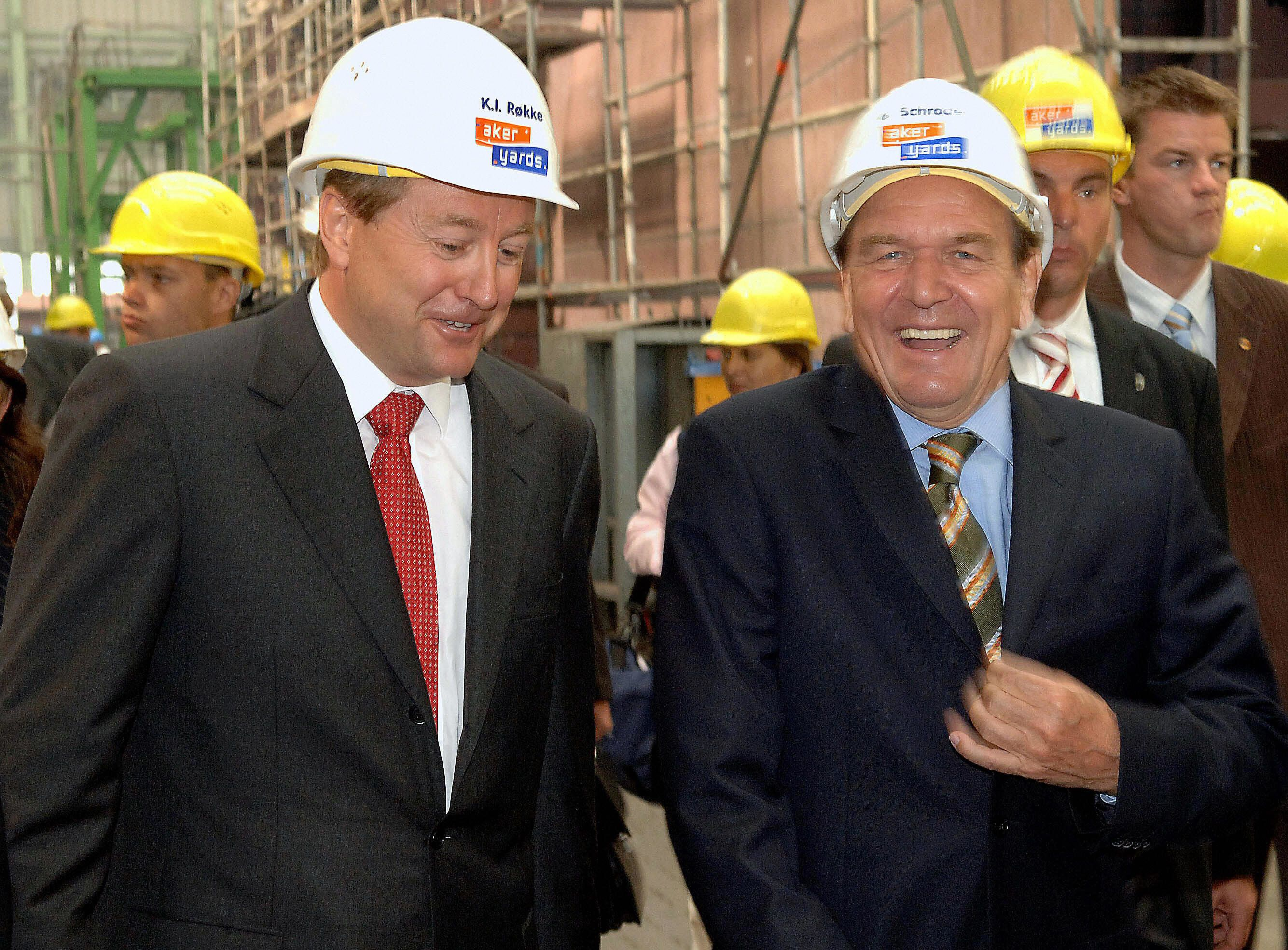 WISMAR, Germany:  German Chancellor Gerhard Schroeder (R) is accompanied by Aker ASA chairman, Norwegian Kjell Inge Rokke (L) during his visit at the company's site on 22 August 2005 in Wismar, northern Germany. Schroeder is on election campaign tour for his Social Democratic SPD party ahead of general elections to take place on 18 September 2005.    AFP PHOTO    POOL/JENS BUETTNER  (Photo credit should read JENS BUETTNER/AFP/Getty Images)