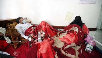 A man and his wife infected with cholera lie on a bed at a hospital in Sanaa, Yemen May 12, 2017. REUTERS/Mohamed al-Sayaghi
