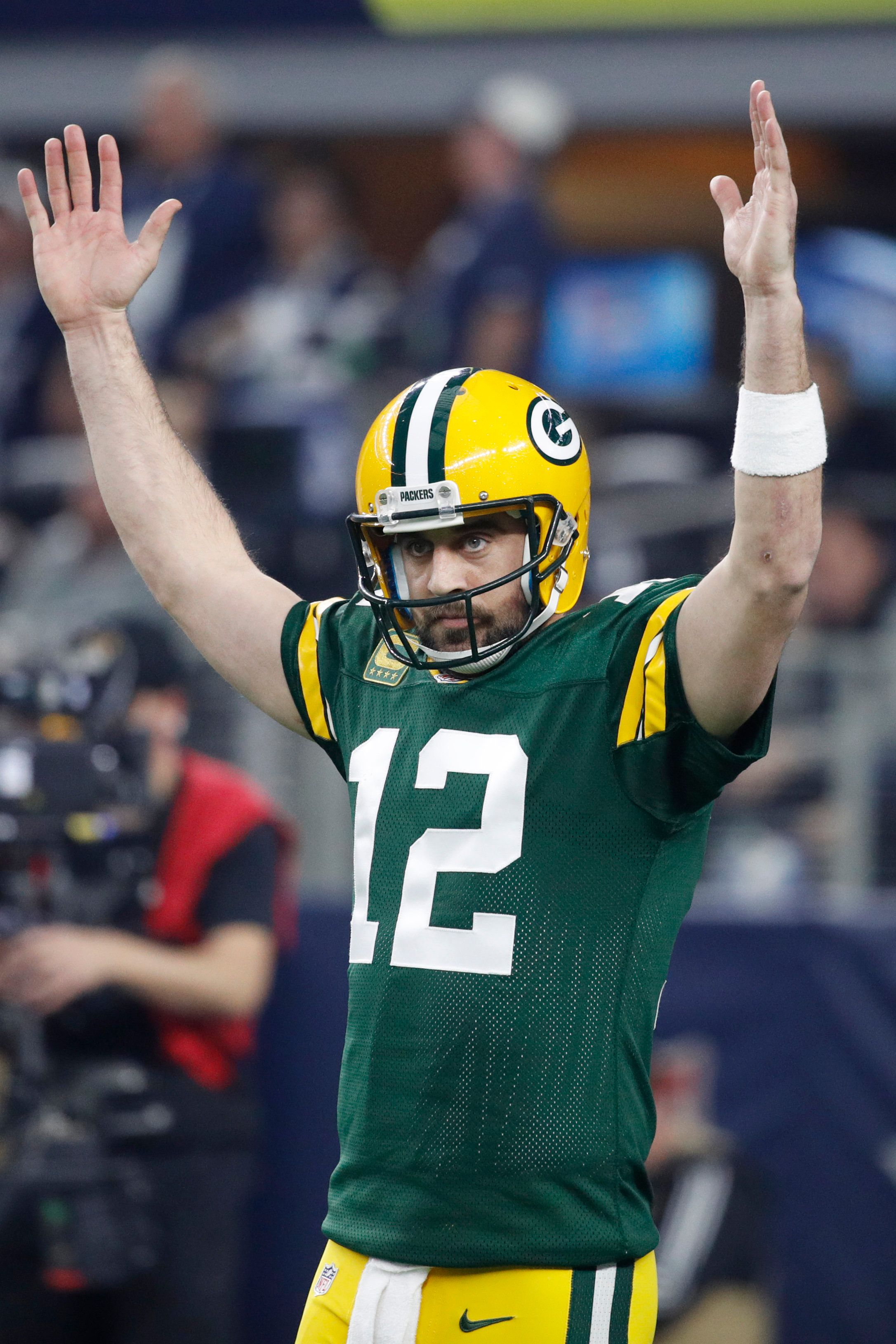 ARLINGTON, TX - JANUARY 15: Aaron Rodgers #12 of the Green Bay Packers reacts after a touchdown during the NFC Divisional Playoff game against the Dallas Cowboys at AT&T Stadium on January 15, 2017 in Arlington, Texas. The Packers defeated the Cowboys 34-31. (Photo by Joe Robbins/Getty Images)