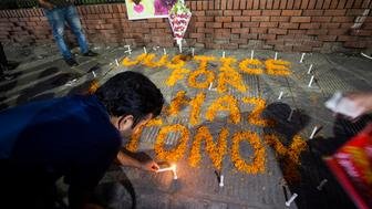 A candle-lit prayer was held in Dhaka, Bangladesh, on 25 April 2017 in remembrance, one year after the gruesome murders of LGBT activists Xulhaz Mannan and his friend Tonoy. The remembrance was organised by an LGBT activist at Shahbagh intersection. Xulhaz was a USAID official and also editor of Bangladeshs first LGBT magazine Roopbaan and was a cousin of former foreign minister and ruling Awami League leader Dipu Moni. A gang of assailants, posing as delivery men, entered Xulhazs apartment building in Dhakas Kalabagan and killed him and his friend Tonoy with machetes on April 25 last year.  (Photo by Ahmed Salahuddin/NurPhoto via Getty Images)