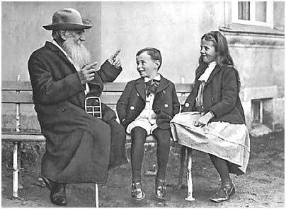 Tolstoy telling a story to his grandchildren