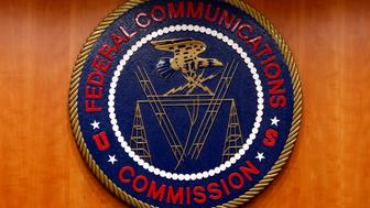 "The Federal Communications Commission (FCC) logo is seen before the FCC Net Neutrality hearing in Washington February 26, 2015. The FCC is expected Thursday to approve Chairman Tom Wheeler's proposed ""net neutrality"" rules, regulating broadband providers more heavily than in the past and restricting their power to control download speeds on the web. REUTERS/Yuri Gripas (UNITED STATES - Tags: POLITICS SCIENCE TECHNOLOGY BUSINESS TELECOMS LOGO)"