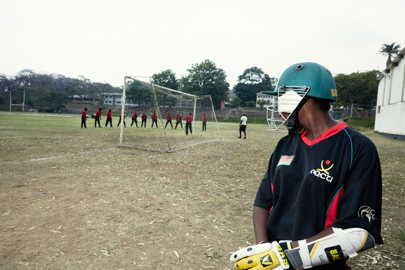 Batsman Dalida watches the Men's National Cricket Team during batting practice, Malawian U19 Women's Cricket Team, Blantyre,