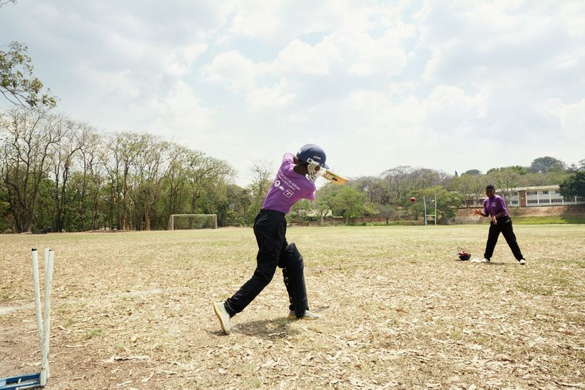 Shahida tries to catch a ball during fielding practice, Blantyre, Malawi, 2016.