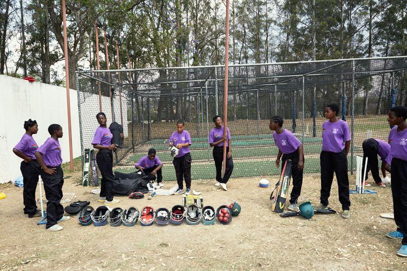 The girls pack away their kits after training, Malawian U19 Women's Cricket Team, Blantyre, Malawi, 2016.