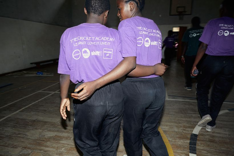 Shahida embraces one of her teammates on their way to a cricket theory class, Malawian U19 Women's Cricket Team, Blantyre, Ma