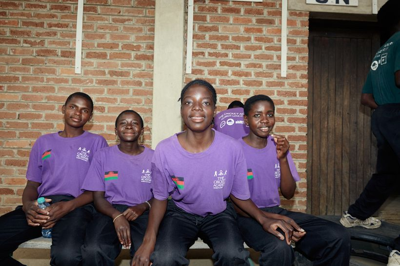 From left to right: Shalani, Triphonia, Chimwemwe, and Tadala wait to begin their cricket theory class, Malawian U19 Women's