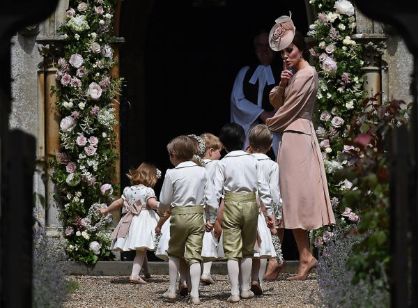 Catherine, Duchess of Cambridge walks with the bridesmaids and pageboys as they arrive for her sister's wedding to James Matt