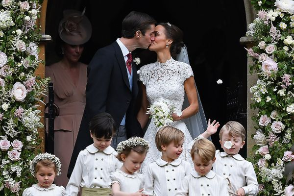Pippa Middleton kisses her new husband James Matthews.