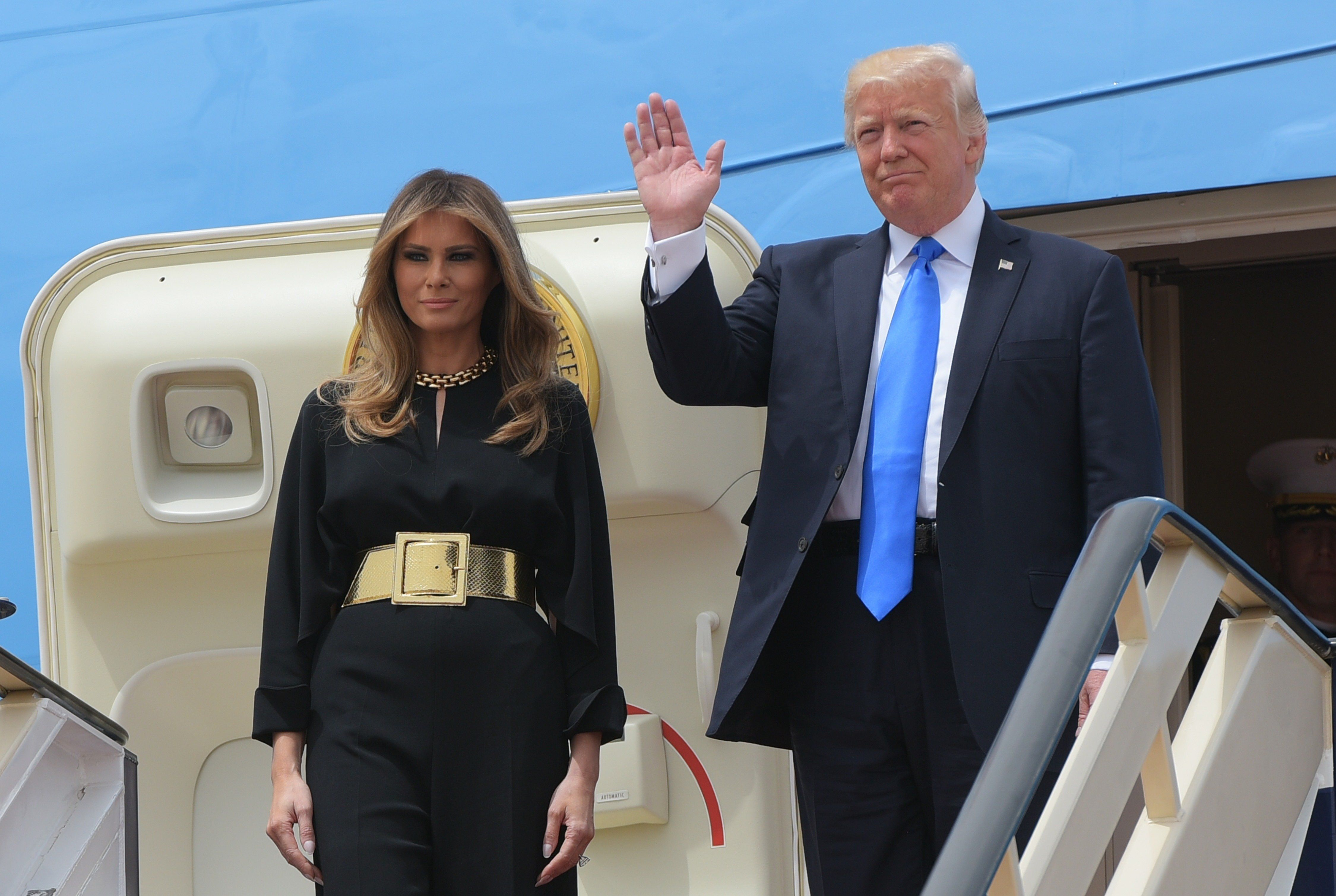US President Donald Trump and First Lady Melania Trump step off Air Force One upon arrival at King Khalid International Airport in Riyadh on May 20, 2017. / AFP PHOTO / MANDEL NGAN        (Photo credit should read MANDEL NGAN/AFP/Getty Images)