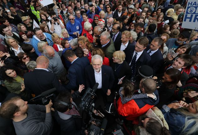 Jeremy Corbyn surrounded by supporters in