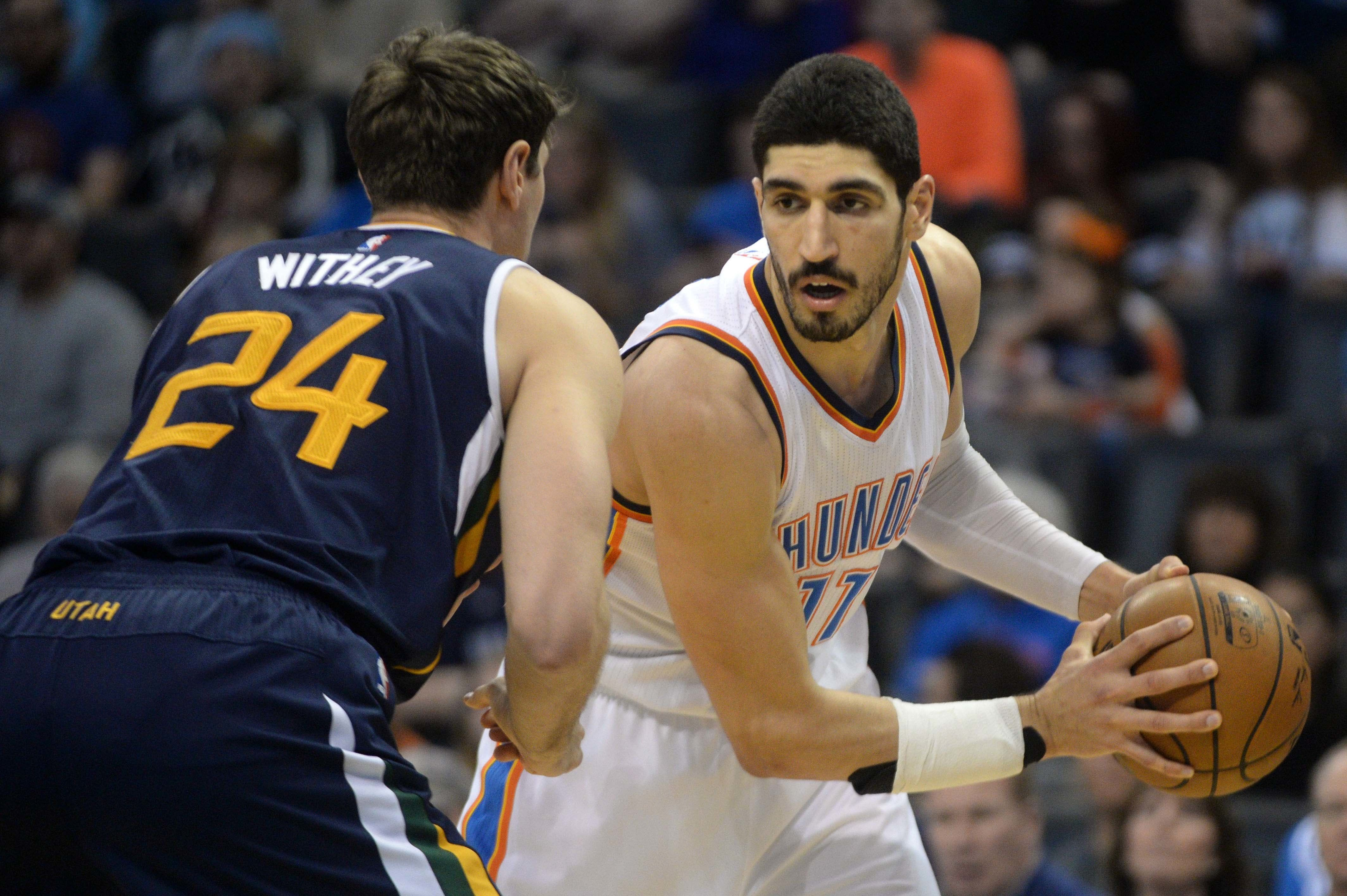 Mar 11, 2017; Oklahoma City, OK, USA; Oklahoma City Thunder center Enes Kanter (11) drives to the basket in front of Utah Jazz center Jeff Withey (24) during the second quarter at Chesapeake Energy Arena. Mandatory Credit: Mark D. Smith-USA TODAY Sports