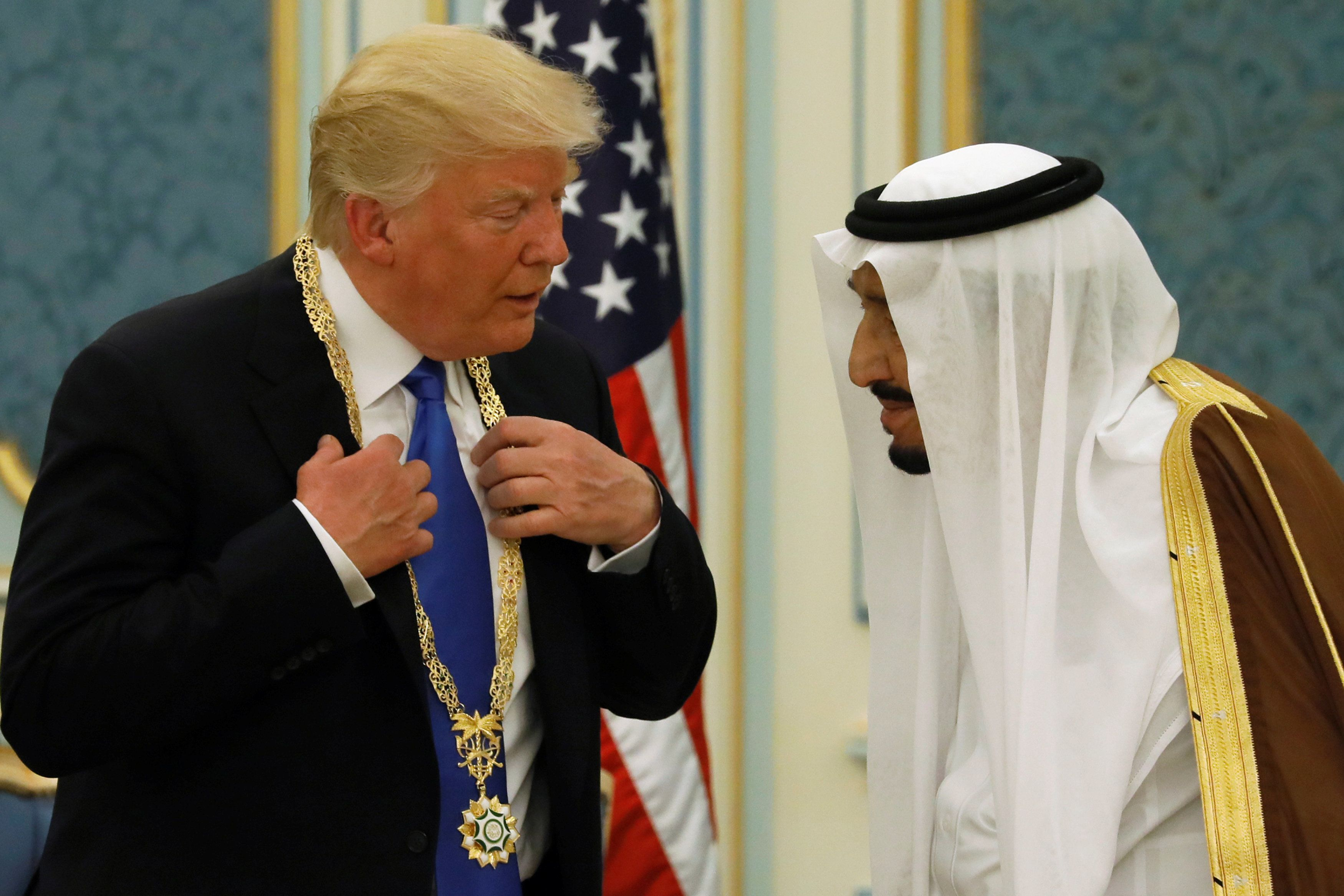 Saudi Arabia's King Salman bin Abdulaziz Al Saud (R) presents U.S. President Donald Trump with the Collar of Abdulaziz Al Saud Medal at the Royal Court in Riyadh, Saudi Arabia May 20, 2017. REUTERS/Jonathan Ernst
