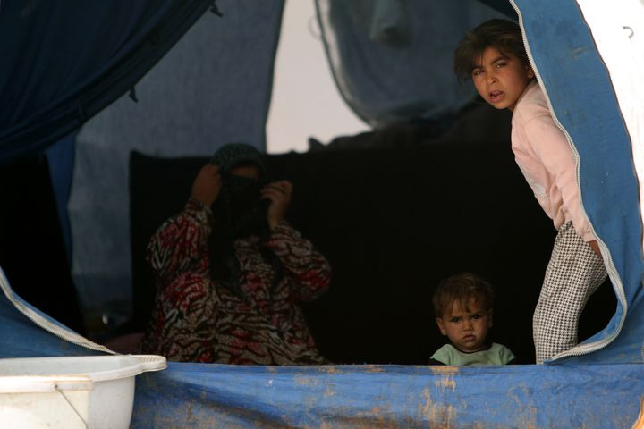 Internally displaced Syrianswho fled the city of Raqqa rest in a tent in Manbij, Syria, on April 6, 2017.