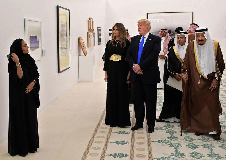 U.S. President Donald Trump, first lady Melania Trump and Saudi Arabia's King Salman bin Abdulaziz al-Saud, at right, look at