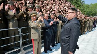 "North Korean leader Kim Jong Un waves to North Korean scientists and technicians, who developed missile ""Hwasong-12"" in this undated photo released by North Korea's Korean Central News Agency (KCNA) May 20, 2017. KCNA/via REUTERS    ATTENTION EDITORS - THIS PICTURE WAS PROVIDED BY A THIRD PARTY. REUTERS IS UNABLE TO INDEPENDENTLY VERIFY THIS IMAGE. FOR EDITORIAL USE ONLY. NOT FOR USE BY REUTERS THIRD PARTY DISTRIBUTORS. SOUTH KOREA OUT."