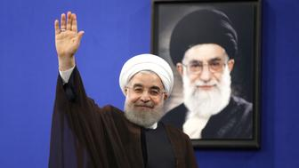 Newly re-elected Iranian President Hassan Rouhani gestures after delivering a televised speech in the capital Tehran on May 20, 2017. Iranians have chosen the 'path of engagement with the world' and rejected extremism, President Hassan Rouhani said following his resounding re-election victory. / AFP PHOTO / ATTA KENARE        (Photo credit should read ATTA KENARE/AFP/Getty Images)