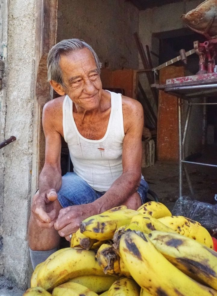 <p>A man sells bananas on the streets of Havana Vieja</p>