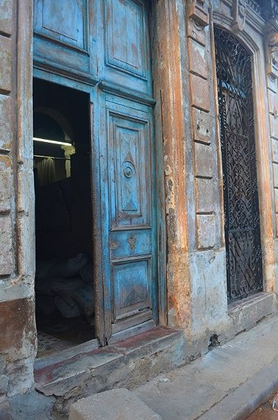 <p>Worn but beautifully  crafted doors make you wonder what this place looked like in it's heyday</p>