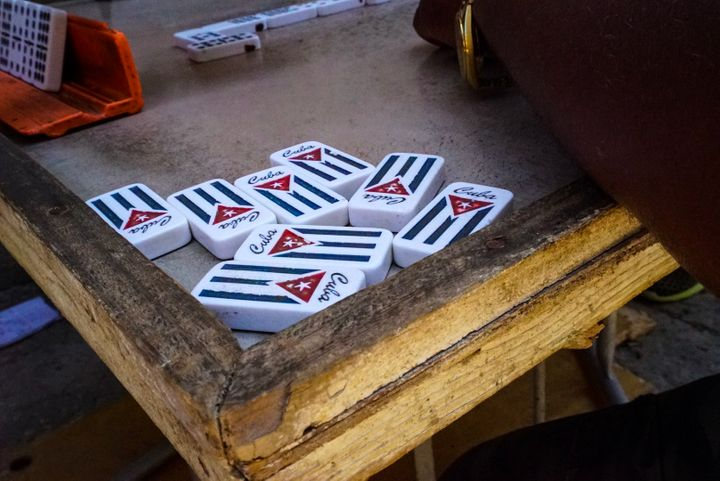 <p>Old men play dominos on the streets of Vedado</p>