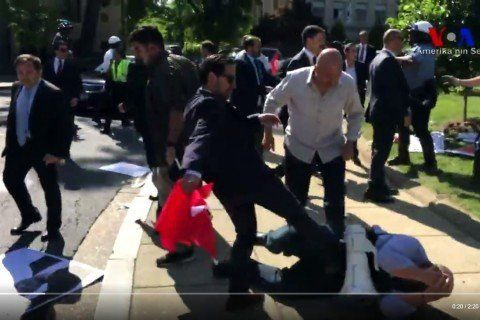 Members of Turkish President Recep Tayyip Erdogan security detail kick an American protester in the face