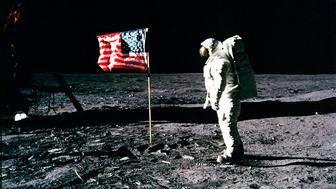 United States astronaut Buzz Aldrin salutes the American flag on the surface of the Moon after he and fellow astronaut Neil Armstrong became the first men to land on the Moon during the Apollo 11 space mission July 20, 1969. July 20, 2012 marks the 43rd anniversary of the moon landing. REUTERS/Neil Armstrong/NASA/Handout (UNITED STATES - Tags: SCIENCE TECHNOLOGY ANNIVERSARY) FOR EDITORIAL USE ONLY. NOT FOR SALE FOR MARKETING OR ADVERTISING CAMPAIGNS. THIS IMAGE HAS BEEN SUPPLIED BY A THIRD PARTY. IT IS DISTRIBUTED, EXACTLY AS RECEIVED BY REUTERS, AS A SERVICE TO CLIENTS