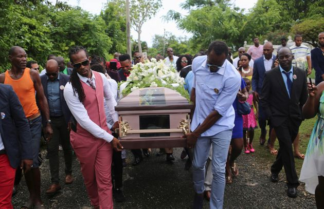 Usain Bolt, right, carries the coffin of former Team GB athlete Germaine Mason, who died in a motorcycle...