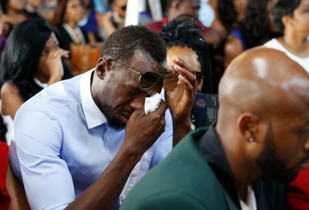 Bolt wipes tears from his eyes during the service for Mason atthe Seventh Day Adventist Church,...