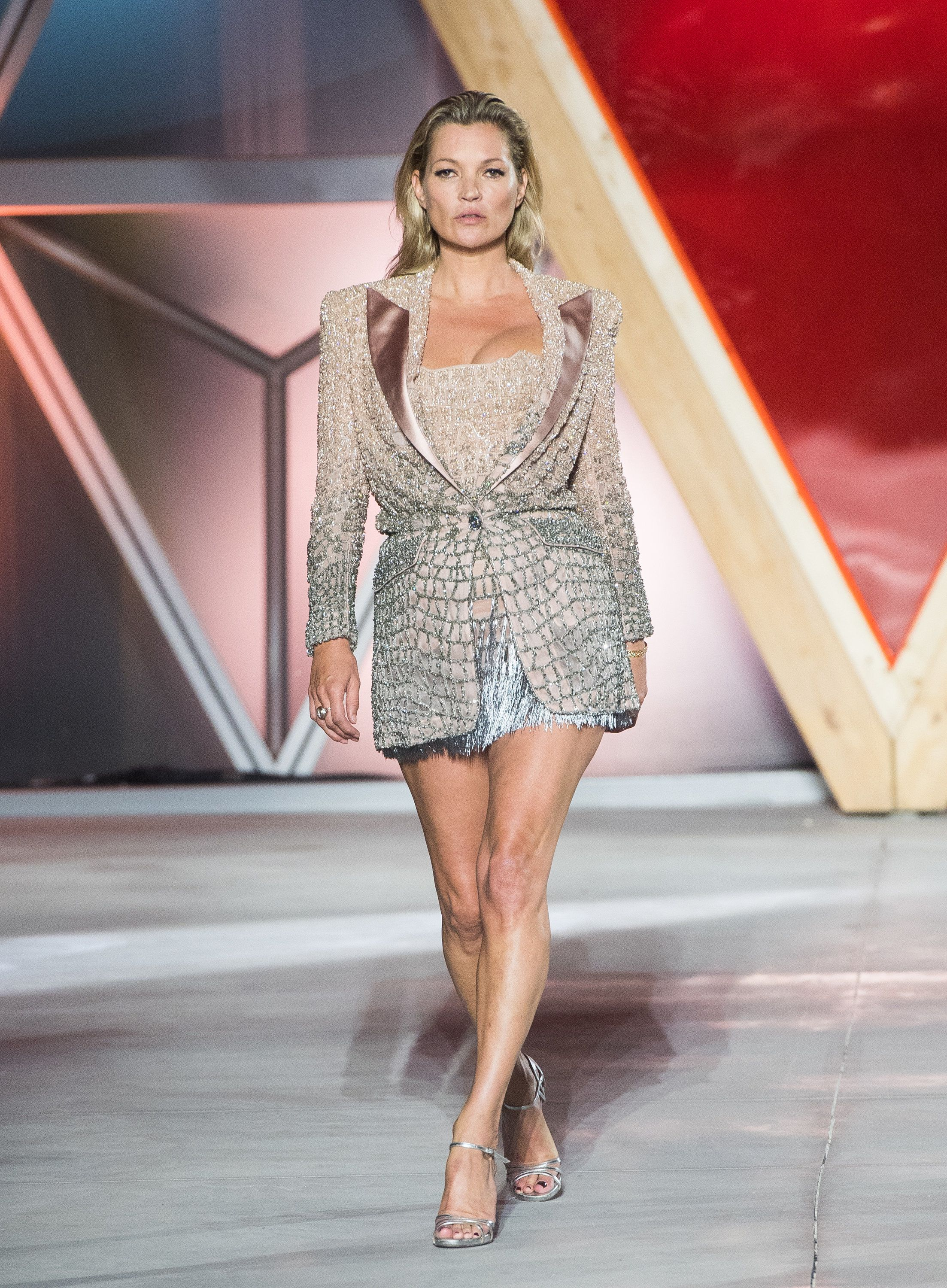 Kate Moss walks the runway at the Fashion for Relief event during the 70th annual Cannes Film Festival...