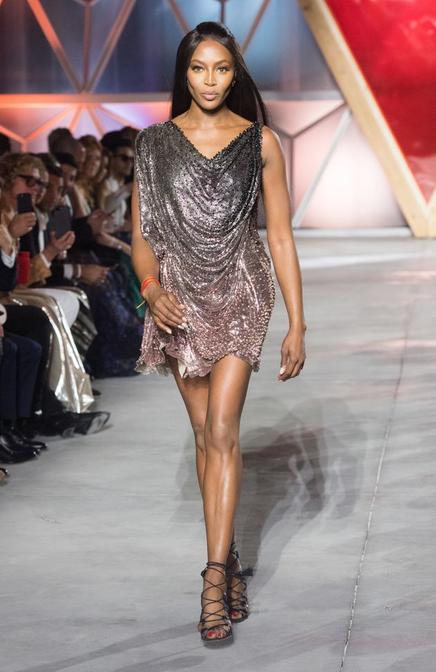 Naomi Campbell walks the runway at the Fashion for Relief event during the 70th annual Cannes Film Festival...