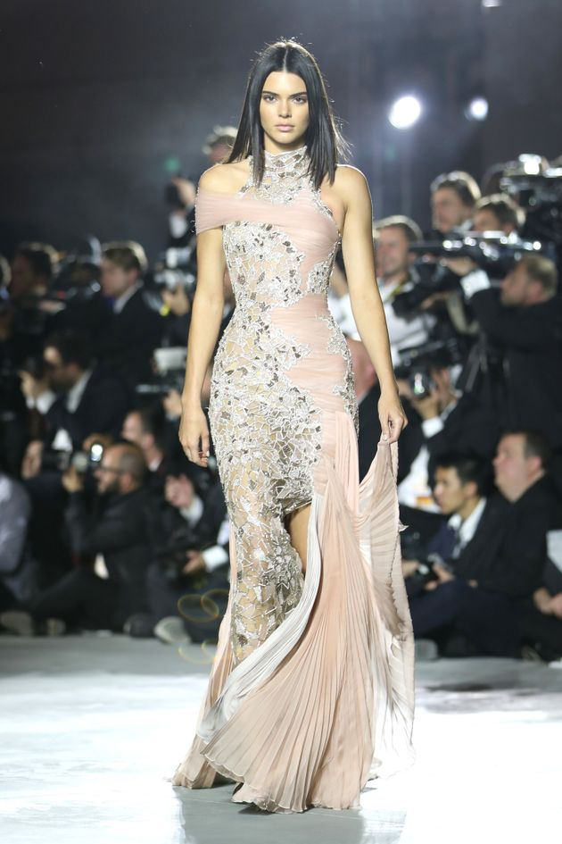 Kendall Jenner walks the runway at the Fashion for Relief event during the 70th annual Cannes Film Festival...