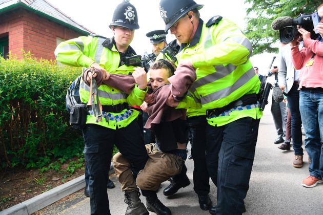 A man was arrested in Wrexham on Monday for staging a protest before Theresa May arrived for a political
