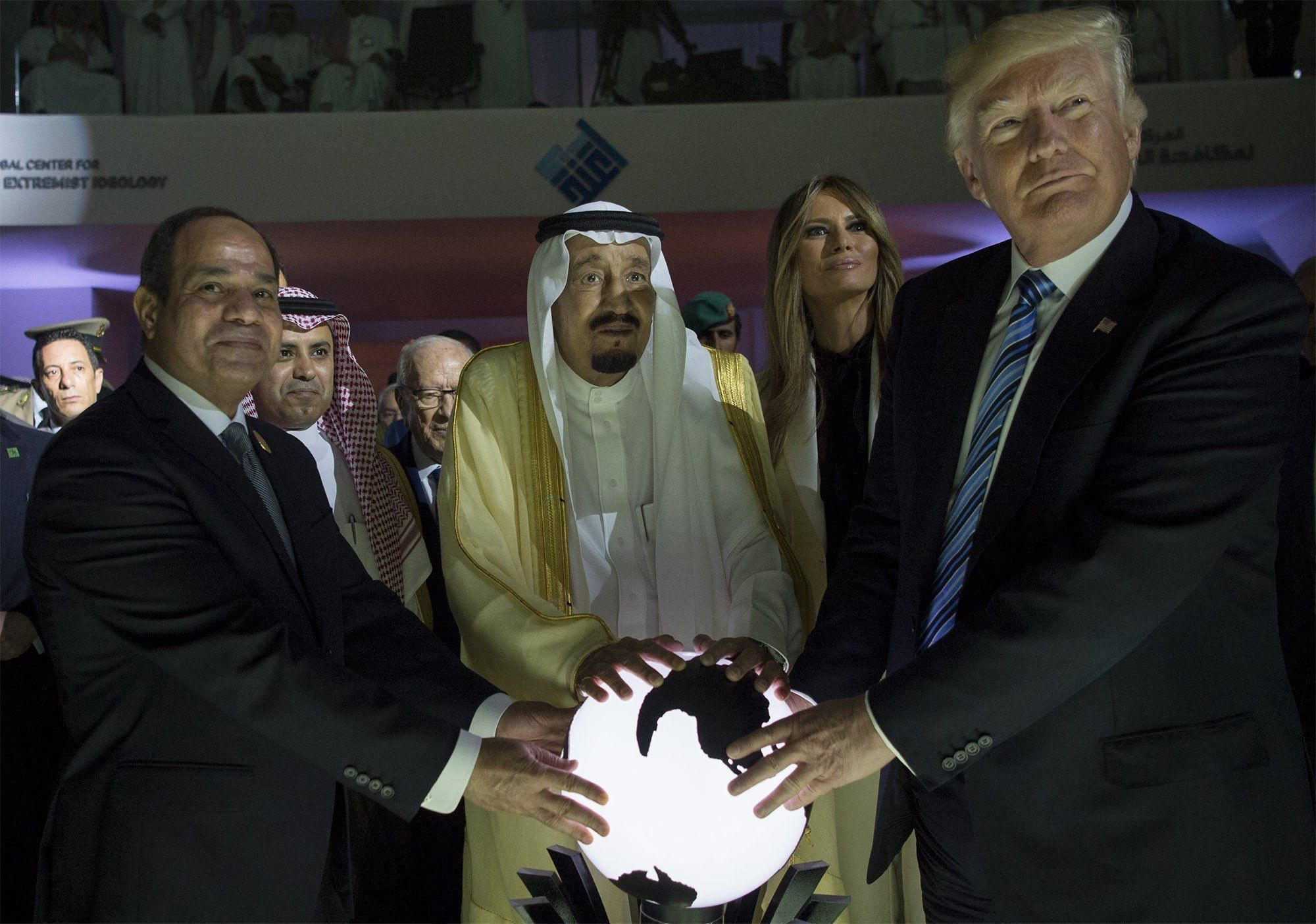 RIYADH, SAUDI ARABIA - MAY 21: (----EDITORIAL USE ONLY  MANDATORY CREDIT - 'BANDAR ALGALOUD / SAUDI ROYAL COUNCIL / HANDOUT' - NO MARKETING NO ADVERTISING CAMPAIGNS - DISTRIBUTED AS A SERVICE TO CLIENTS----)US President Donald Trump, US First lady Melania Trump (2nd R), Saudi Arabia's King Salman bin Abdulaziz al-Saud (2nd L) and Egyptian President Abdel Fattah el-Sisi (L) put their hands on an illuminated globe  during the inauguration ceremony of the Global Center for Combating Extremist Ideology in Riyadh, Saudi Arabia on May 21, 2017. (Photo by Bandar Algaloud / Saudi Royal Council / Handout/Anadolu Agency/Getty Images)