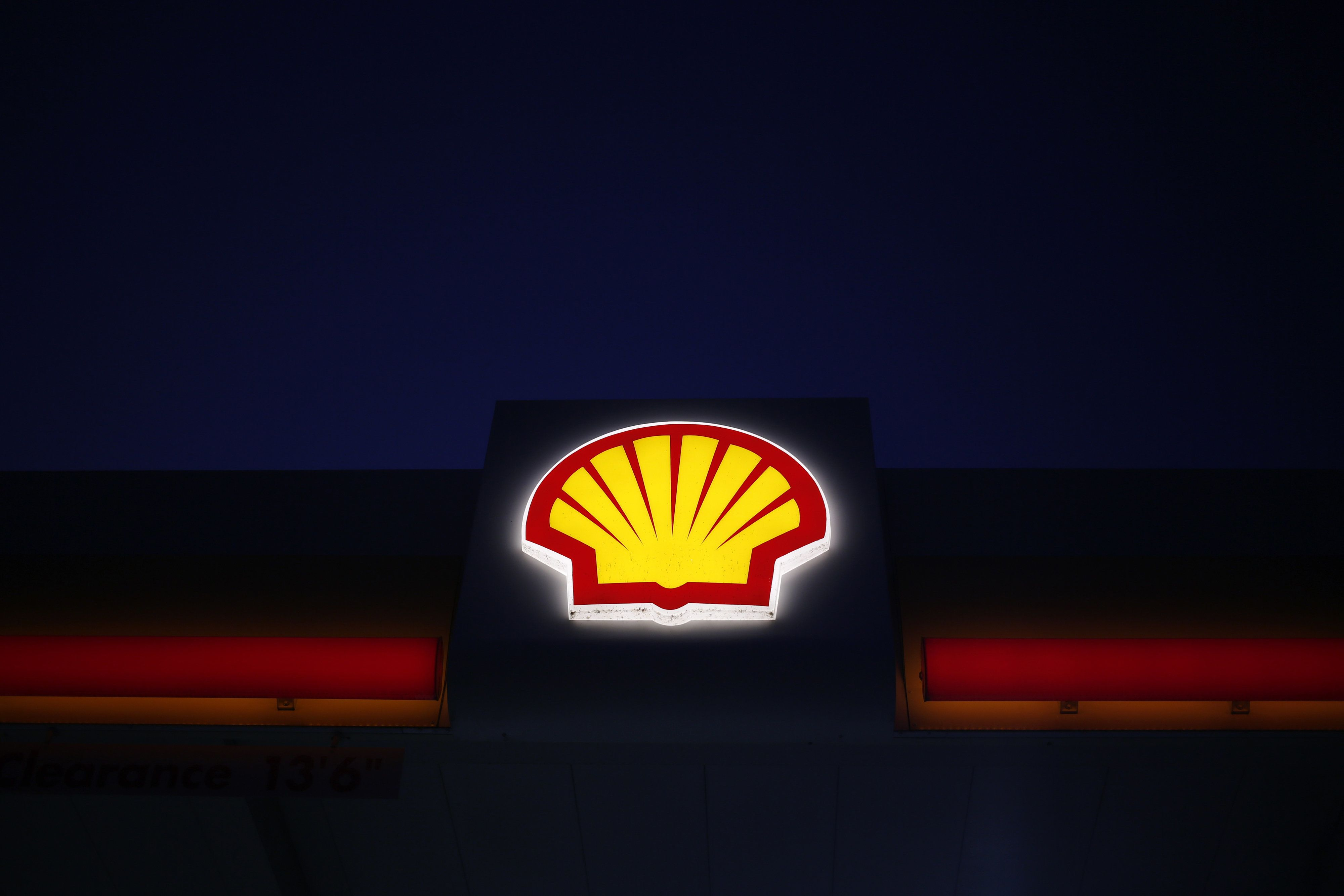 Signage is displayed at a Royal Dutch Shell PLC gasoline station in Louisville, Kentucky, U.S., on Wednesday, July 20, 2016. Royal Dutch Shell is scheduled to release earnings figures on July 28. Photographer: Luke Sharrett/Bloomberg via Getty Images