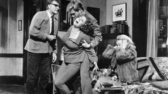 Richard Burton as George, Elizabeth Taylor as Martha, George Segal as Nick, and Sandy Dennis as Honey in the 1966 film Who's Afraid of Virginia Woolf? (Photo by �� John Springer Collection/CORBIS/Corbis via Getty Images)