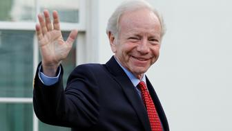 Former Senator Joe Lieberman waves as he leaves after a meeting with President Donald Trump for candidates for FBI director at the White House in Washington, U.S., May 17, 2017. REUTERS/Yuri Gripas