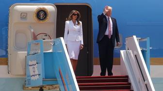U.S. President Donald Trump (R), and his first lady Melania Trump, waves upon arrival at Ben Gurion International Airport in Lod near Tel Aviv, Israel May 22, 2017. REUTERS/Jonathan Ernst