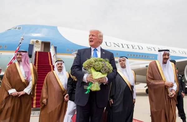 Trump is welcomed by Saudi Arabia's King Salman bin Abdul-Aziz Al Saud Salman (far right) as he arrives at King Khalid I