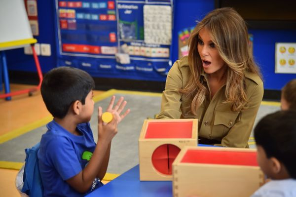 The first lady chats with students during a visit to the American International School in Riyadh on May 21, 2017.