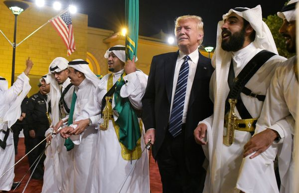 Trump joins dancers with swords at a welcome ceremony ahead of a banquet at the Murabba Palace on May 20, 2017.
