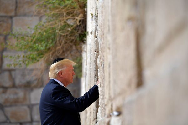 Donald Trump visits the Western Wall, the holiest site where Jews can pray, in Jerusalem's Old City on May 22, 2017.
